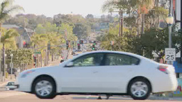 Cars drive on street in Los Angeles Footage