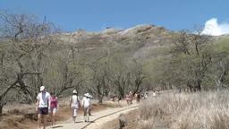 People walking on trail of Diamond Head Footage
