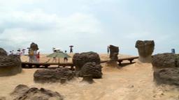 People walking at beach with strange shaped rocks in Yeliu, Taiwan Footage