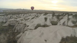 Balloon floating over rocky valley in Cappadocia, Turkey Footage