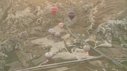 Balloons floating over rocky valley in Cappadocia, Turkey Footage