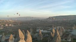 Balloons flying over rocky valley in Cappadocia, Turkey Footage