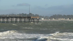 Waves rush under pier in Santa Barbara Footage