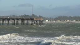 Waves rush under pier in Santa Barbara Footage