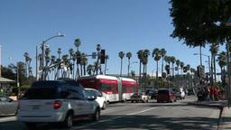 Pedestrians cross busy street in Santa Monica Footage