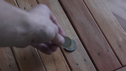 2 Euro Coins On Table stock footage