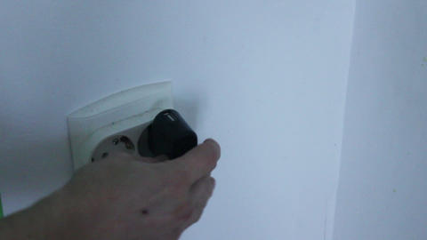 charger plugged into the wall Footage