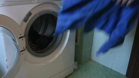 removing clothes from the washing machine Footage