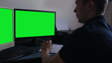 young man at office green screen monitors Footage