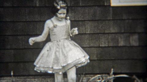1936: Confident ballet girl solo dancing in front of house Footage