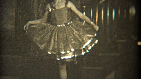 1936: Dancer Practicing Her Craft Indoors With Fancy Dress stock footage