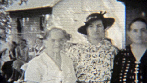1937: Before the smile was invented, these fine ladies just look Footage