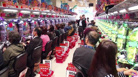 20of 23 People playing Pachinko , arcade games , gambling , slot machines , Japa Footage