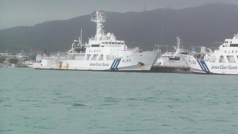 Japanese Coast Guard Ships in Okinawa Islands 01 tracking shot Footage