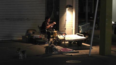 Okinawa Islands Street at Night 04 street artist handheld Stock Video Footage
