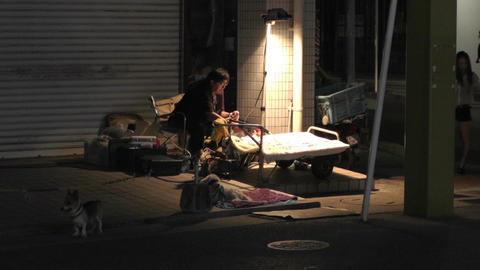 Okinawa Islands Street at Night 04 street artist handheld Stock Video Footage
