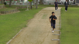 Park in Okinawa Islands 04 running boy Stock Video Footage