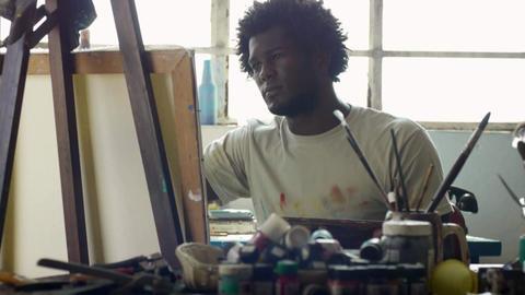 Professional Painter Working In Studio Black Man Painting Artistic Work Footage