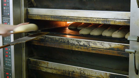 german bakery fill up an oven with bread 4k 11696 Footage