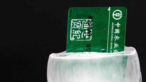 Chinese Bank Card Frozen in Ice Stock Video Footage