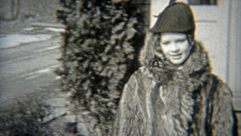 1938: Young Girl Wearing Mom's Fur Coat Around stock footage