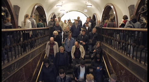 crowd of people walking down the stairs in the subway Footage