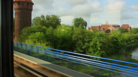 Train window view of the medieval castle by the river Footage