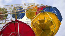 Underside View Of A Ferris Wheel Over Cloudy Sky stock footage