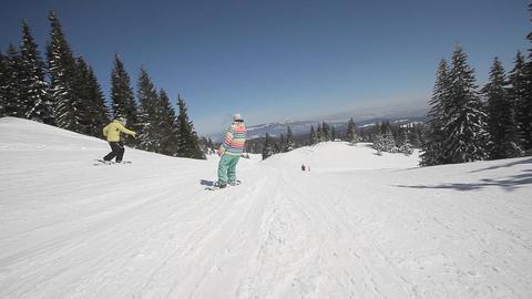 Snowboarder perform tricks Footage