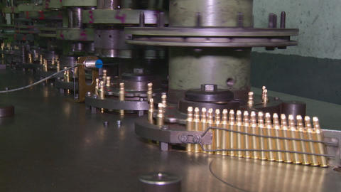 Factory of ammunition, bullets for rifle on production line Stock Video Footage