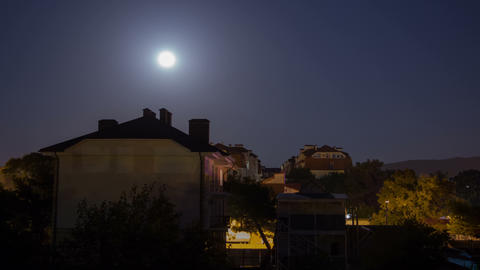 Full moon rising over city timelapse motion Footage