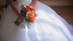 the bride holds a wedding bouquet of flowers 1 ビデオ