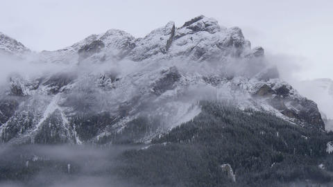 clouds along dolomite smowy summit 4k 11705 Footage