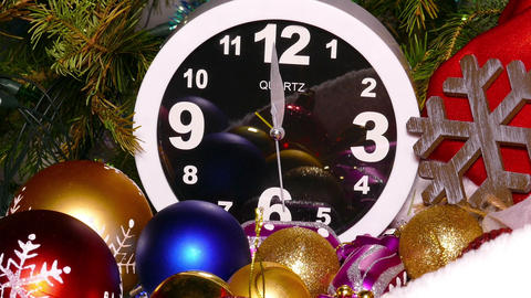 Clock and christmas balls and toys in a red bag Footage