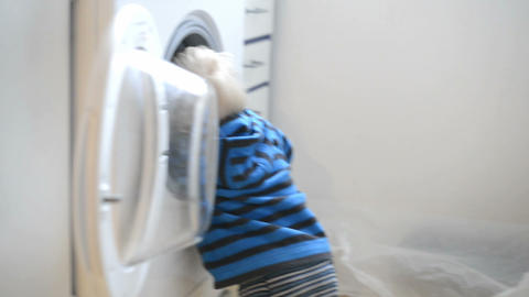 Toddler playing with the washing machine Footage