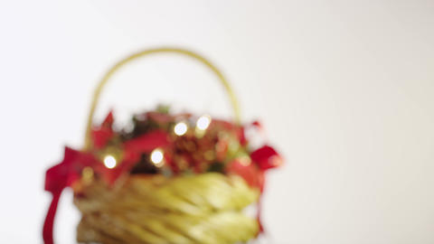 Christmas Basket With Berries, Leaves, Pine Cones And Garland stock footage