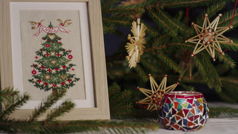 Cross stitch and wooden ornaments for Christmas trees Footage