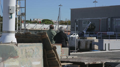 Old Couple Relaxing Together At The Fishboat Harbor Of Lisbon stock footage