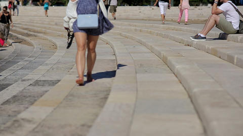 girl walking barefoot at stage, amphitheater belem portugal Footage