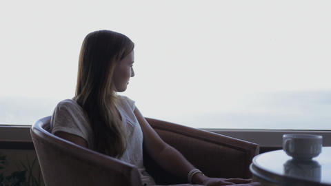 young beautiful girl sits in a cafe beholding beautiful panoramic views of atlan Footage
