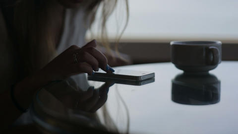 close up hands of young beautiful girl sits in a cafe with panoramic view. Morni Live Action