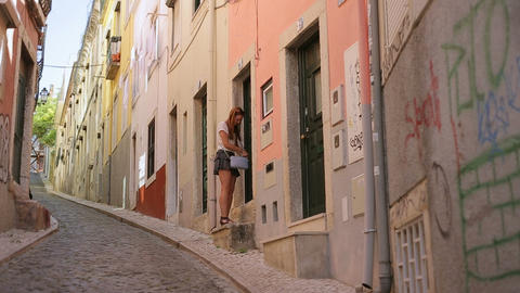 Young Woman With Handbag Loocking Door And Leaving Her Home At Lisbon Street Por stock footage