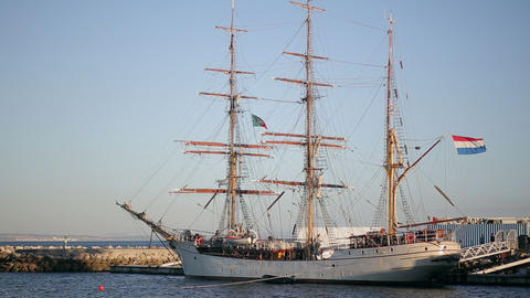 Sailing ship in the bay in cascais marina, coastline of atlantic ocean in portug Footage