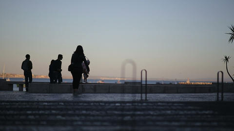 Silhouettes Of People And Triffic At The Embankment. Cascais, Portugal - Septemb stock footage