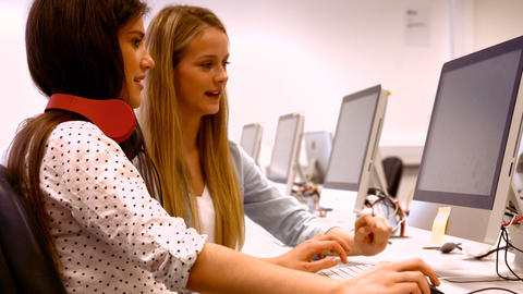 Two students working on computers Footage