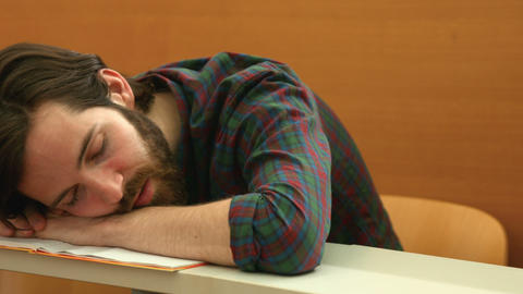 Student asleep with head on his desk Live Action