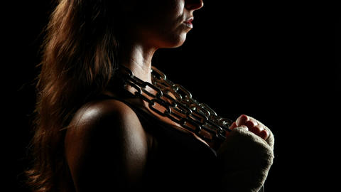 Muscular woman wearing bandage and holding chain Footage