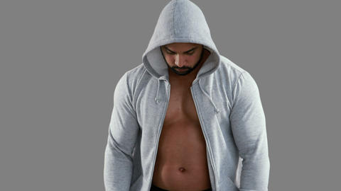 Muscular man wearing grey hood Live Action