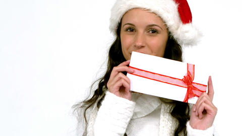 Festive brunette holding a gift Footage