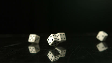 Dice falling and bouncing Live Action